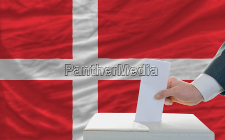 man voting on elections in denmark