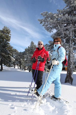 older couple cross country skiing