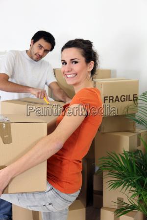 couple unpacking their belongings