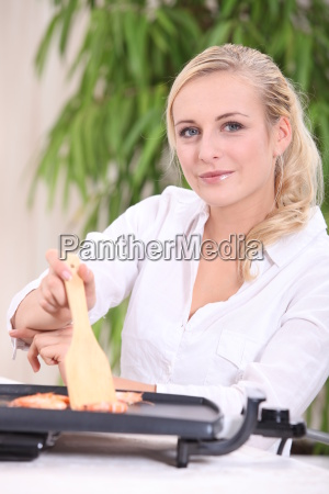 woman sitting at a table using