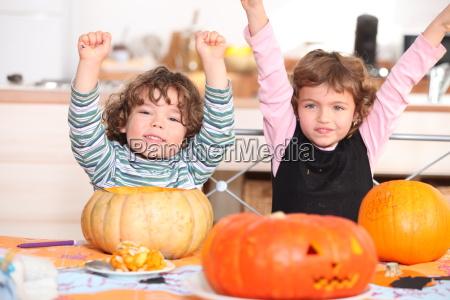 brother and sister calving pumpkins