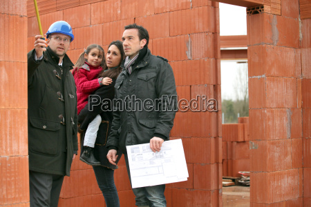 family having their new home inspected