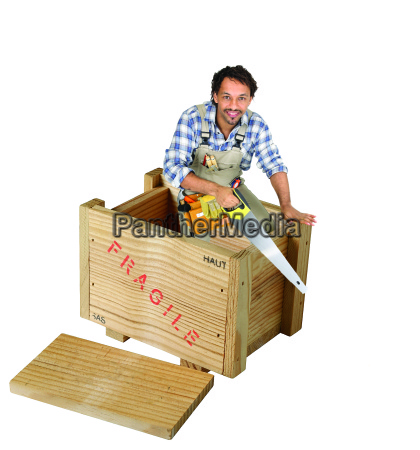 carpenter with saw stood in wooden