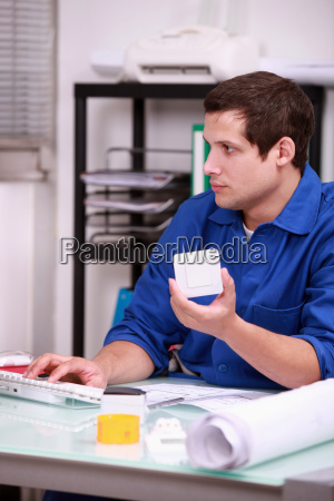 warehouse worker ordering new parts on