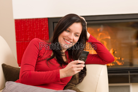fireplace woman with phone lying home