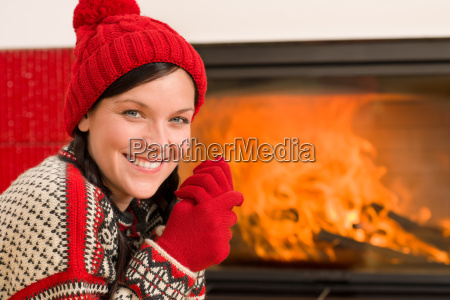 fireplace warming up happy woman winter