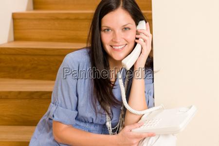 home living woman call phone sitting