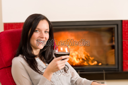 winter home fireplace woman glass red