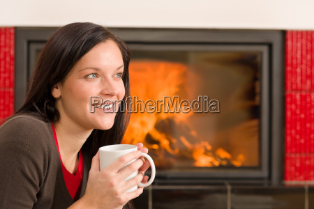 winter home fireplace woman drink hot