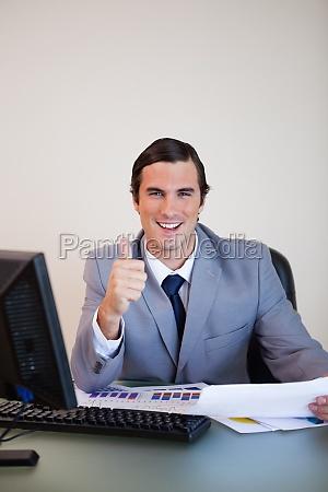 businessman approving statistics