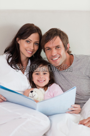 portrait of parents reading a story