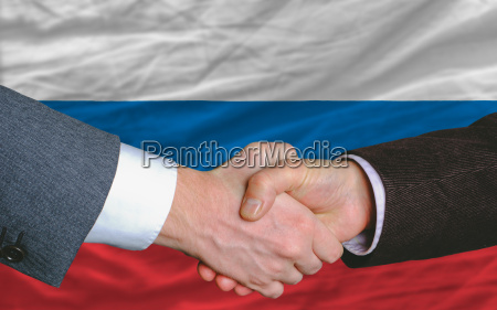 businessmen handshake after good deal in