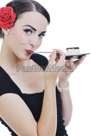 hermosa mujer joven comer dulce pastel