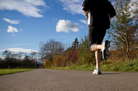 jogger on a dirt road