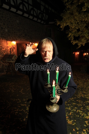 monk with candle holders