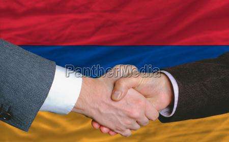 businessmen handshake after good deal in