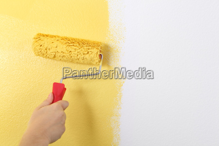 painting the wall with a paint