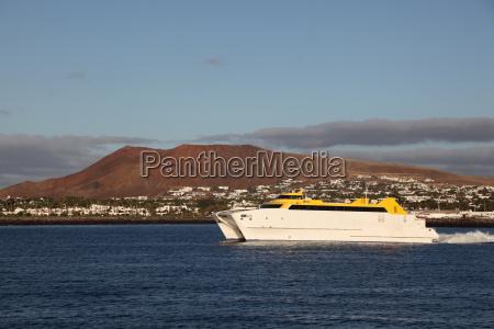 fast ferryboat leaving playa blanca lanzarote