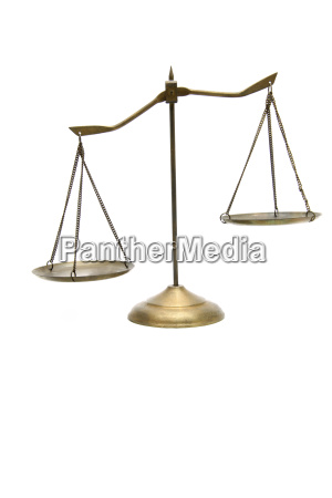 unbalance of golden brass scales of