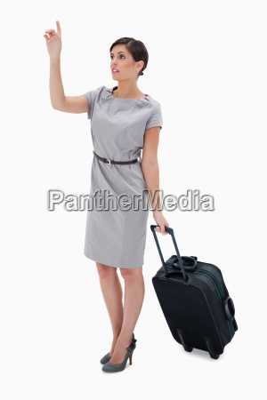 woman with wheely bag calling a