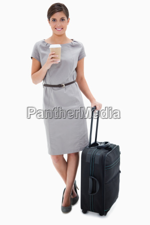 woman with coffee and wheely bag
