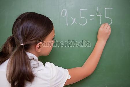 schoolgirl writing a result