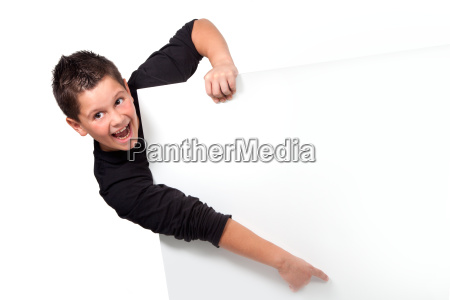 portrait of teen boy pointing finger