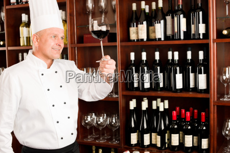 chef cook hold wine glass in