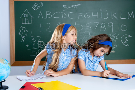 classroom with two kids students cheating