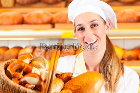 baker sells bread in the basket