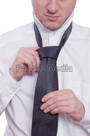 two hands with tie