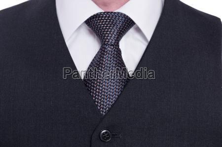 vest tie and shirt