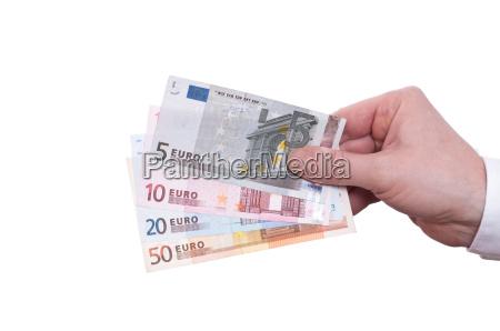 hand and euro bills