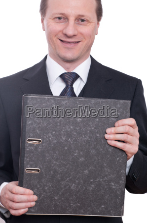 laughing in suit and holding folder