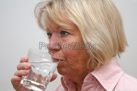 senior with water glass
