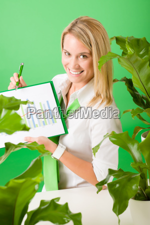 green business office woman show charts