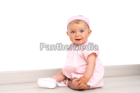 baby girl with blue eyes sitting