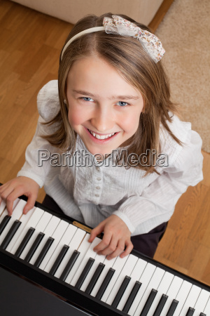 playing the piano at home