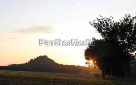 sunset field evening evening sky firmament