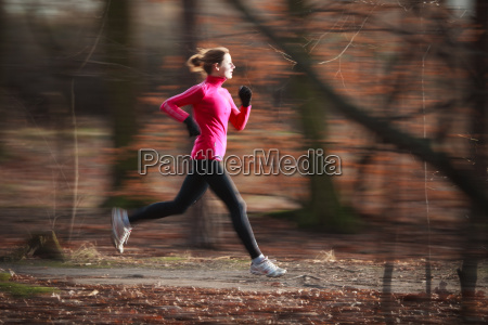 young woman running outdoors in a