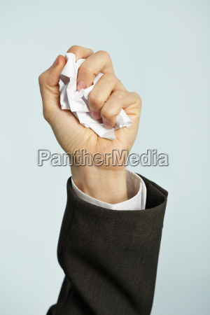hand crumples paper hated work