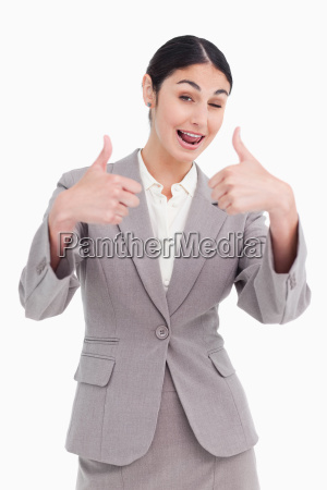 cheering businesswoman giving thumbs up
