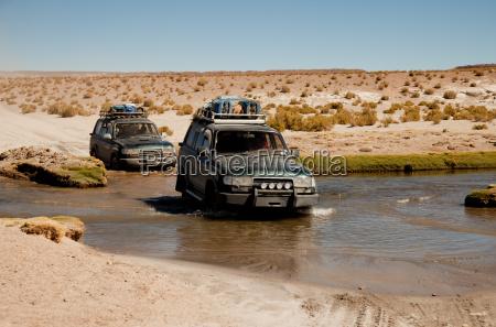 land rover in river bolivia altiplano