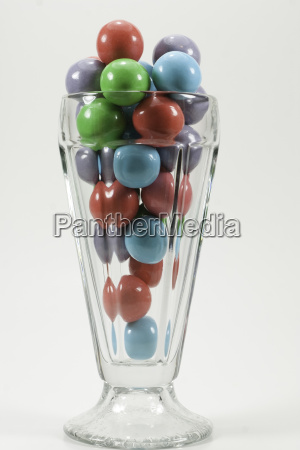 sundae glass filled with gumballs