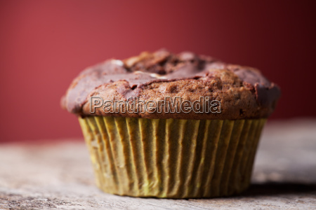 single muffin on red background