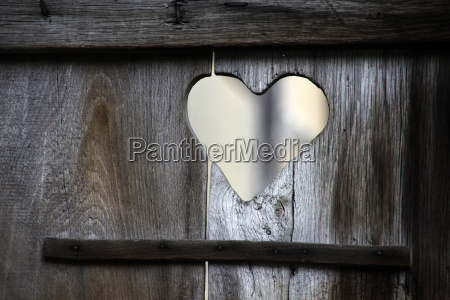 heart in an old toilet door
