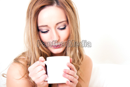 young woman with a cup of