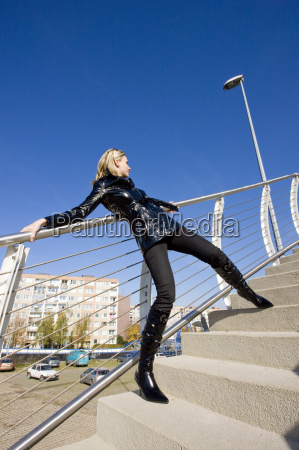 standing woman wearing black clothes