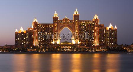 atlantis hotel illuminated at night palm