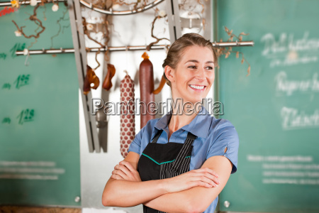 woman or butcher stands in a